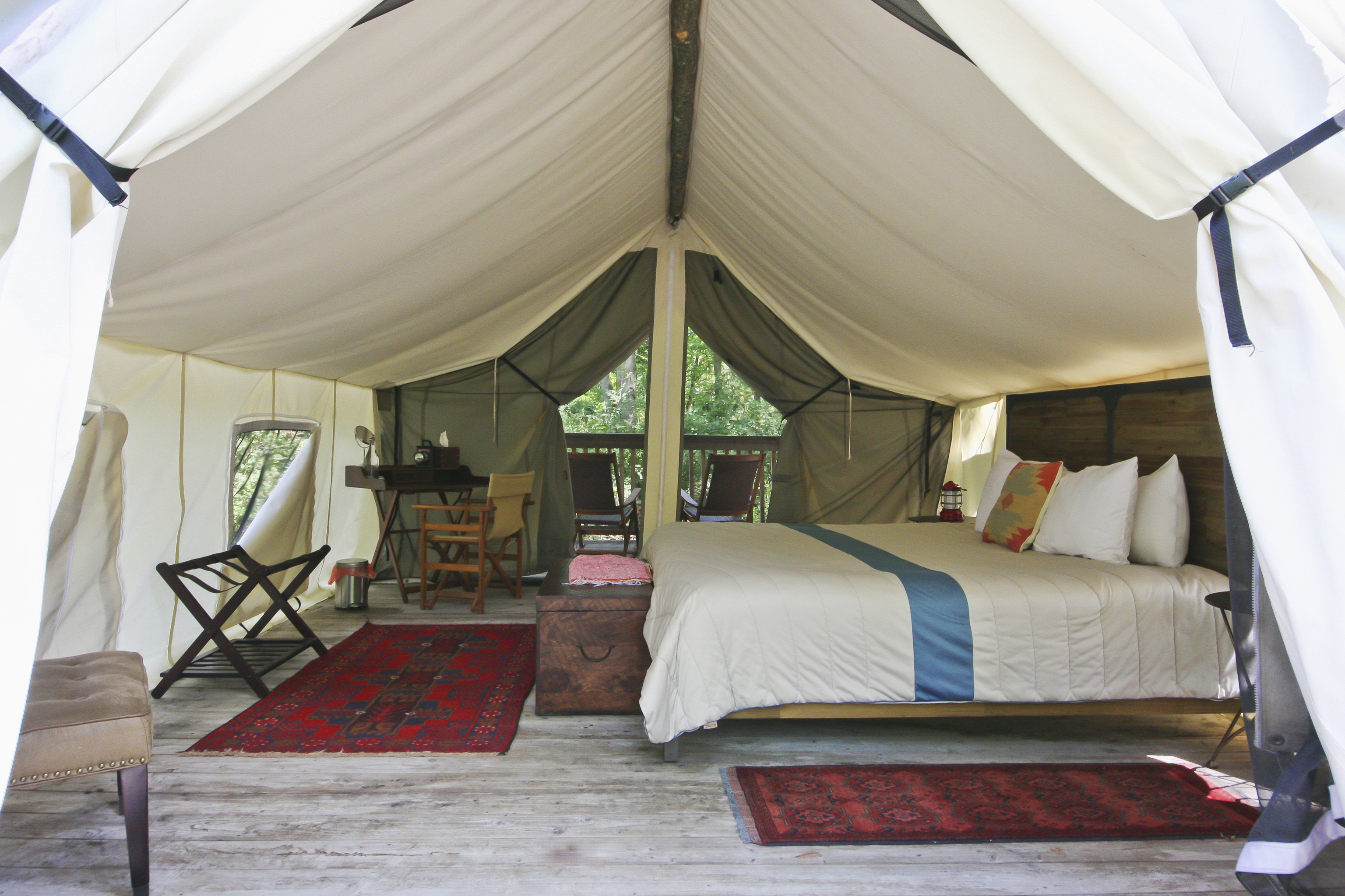 Glamping Outdoors + Adventure Weekend Getaways indoor floor tent room Bedroom camp estate outdoor object furniture