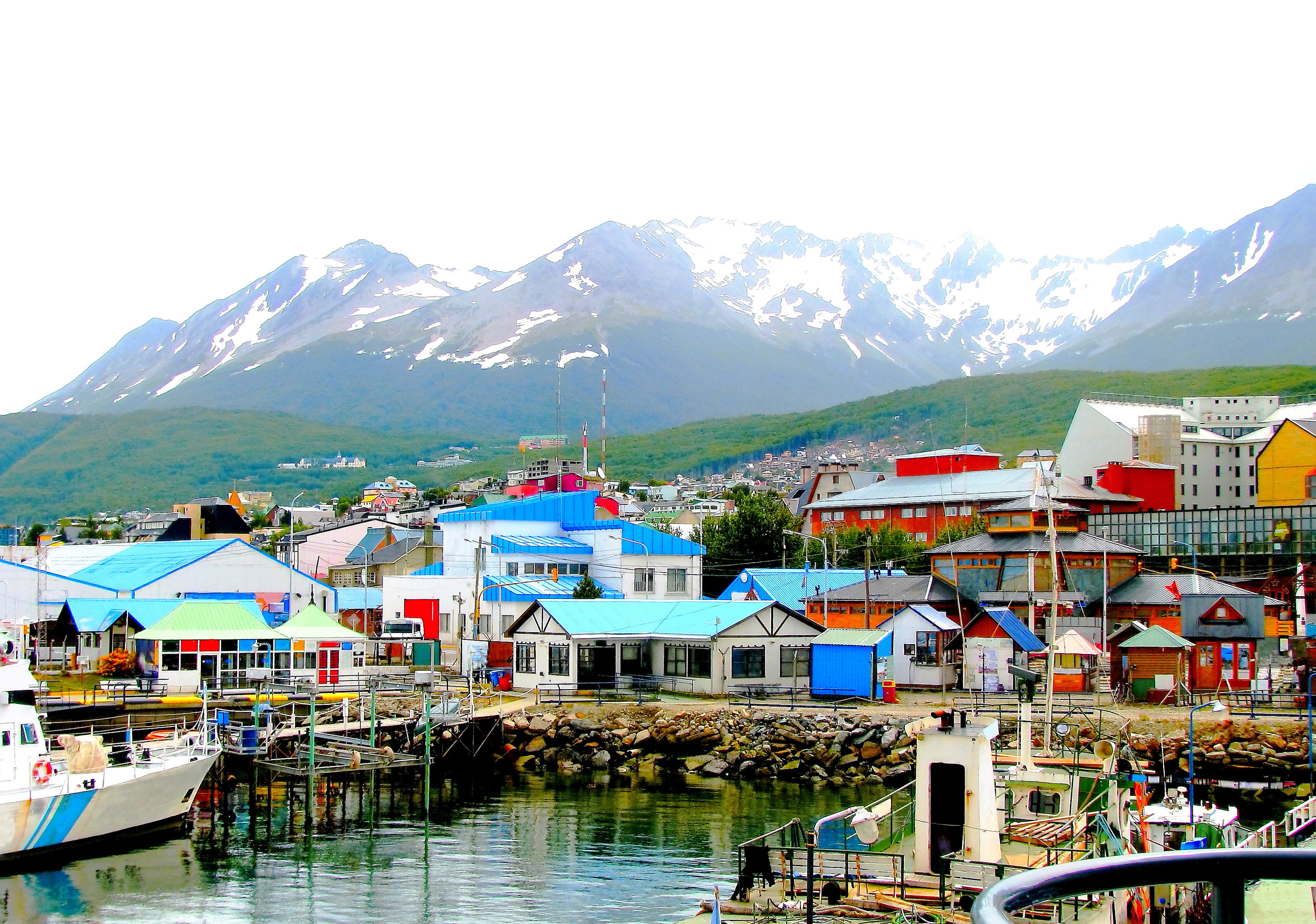 Outdoors + Adventure mountain sky scene water Boat outdoor Harbor Town tourism mountain range leisure hill station docked City fjord Lake mount scenery dock Village glacial landform resort town landscape distance