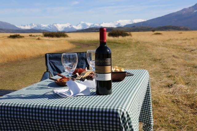drinking empty glasses grass Jetsetter Guides mountain outdoor outdoor dining Packing Tips Picnic sky Travel Tips Trip Ideas wine