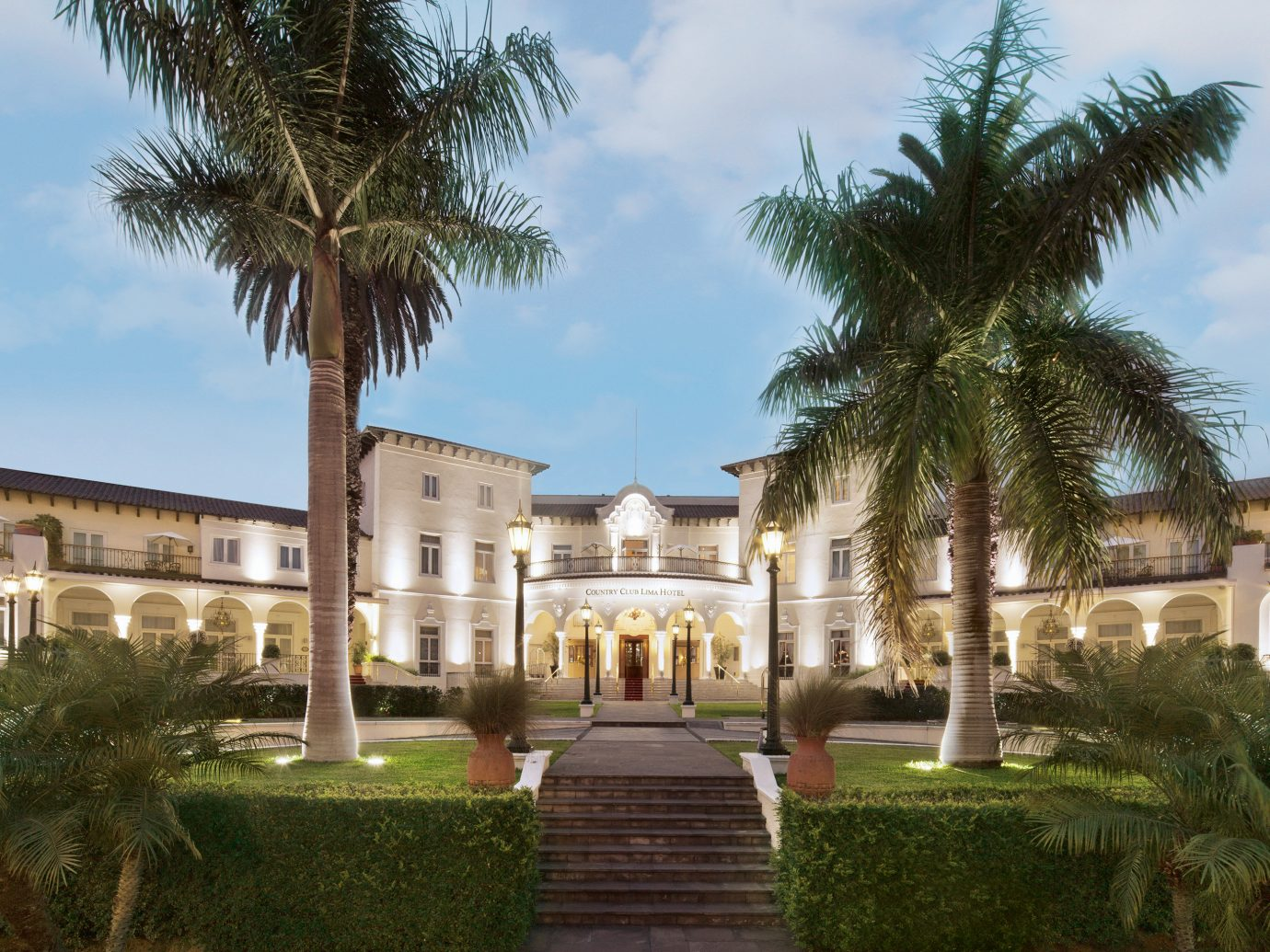 Architecture Boutique Hotels Buildings Design Exterior Hotels Resort Romance sky outdoor tree grass property plant estate building palace palm vacation arecales plaza mansion home hacienda Villa Courtyard Garden