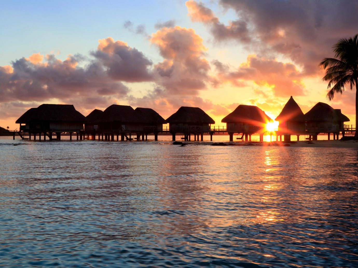 Architecture Buildings Hotels Overwater Bungalow Resort Scenic views Sunset water outdoor sky Sea horizon Ocean dusk Coast sunrise evening Beach bay dawn reflection sunlight cape clouds shore day