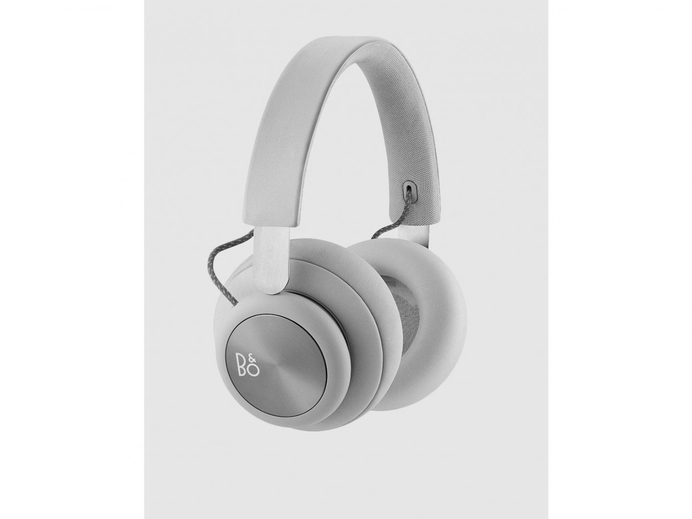 Gift Guides Style + Design Travel Shop earphone electronics headphones technology audio equipment audio product headset product design electronic device white