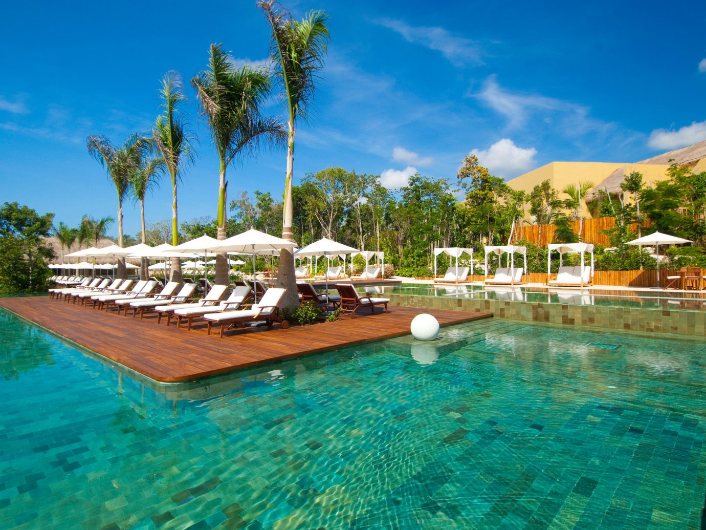 All-Inclusive Resorts Beach Beachfront Elegant Family Travel Hotels Living Lounge Luxury Modern Pool Romance tree sky water outdoor swimming pool property leisure Resort estate vacation resort town Lagoon Villa swimming bay caribbean blue surrounded Garden