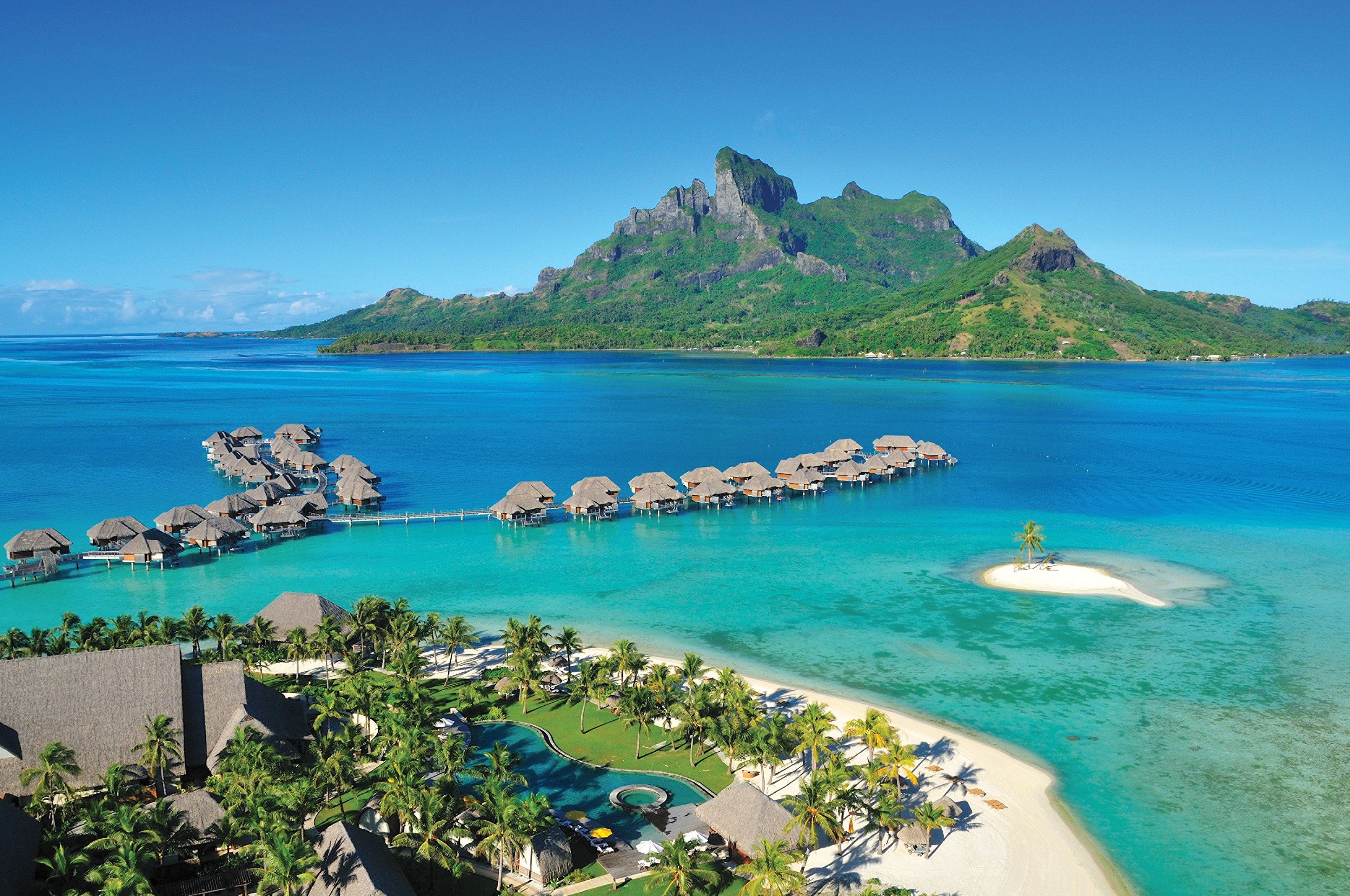 All-Inclusive Resorts Boutique Hotels Grounds Hotels Island Luxury Overwater Bungalow Romance Scenic views Trip Ideas Tropical water sky outdoor mountain Nature landform geographical feature Lake promontory caribbean Sea Coast vacation islet archipelago bay Beach Lagoon Resort cape cove resort town reef shore swimming pond