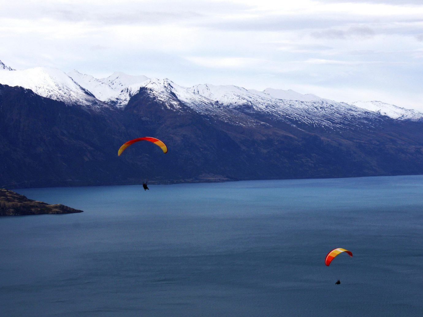 Offbeat Trip Ideas water sky mountain outdoor paragliding air sports sports Nature Lake windsports atmosphere of earth Ocean Sea flight extreme sport parachuting distance day
