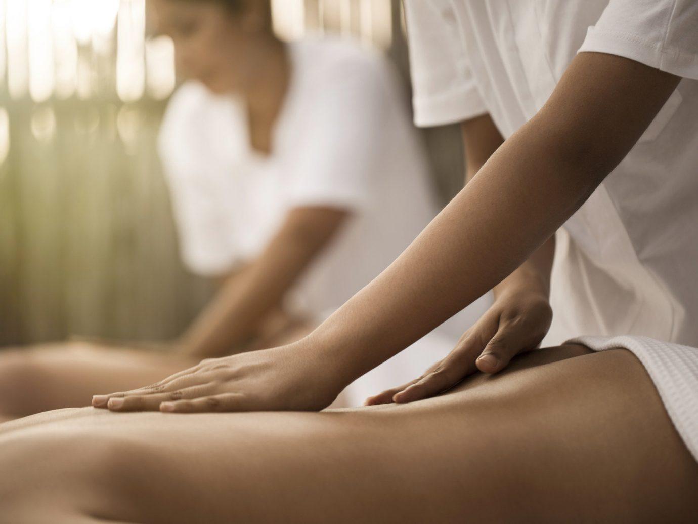 Health + Wellness Spa Retreats Travel Tips person indoor massage leg sense human body