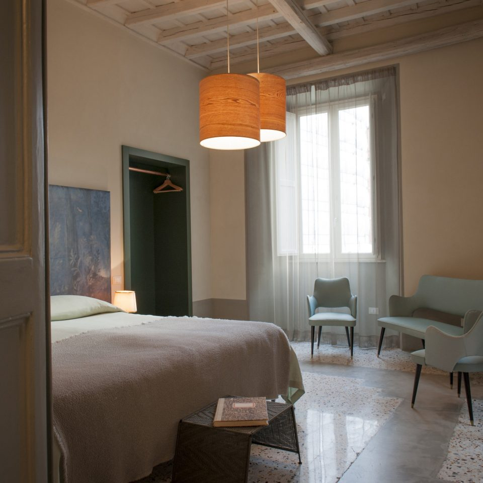 Boutique Hotels Hotels indoor wall floor room bed window Architecture interior design hotel Bedroom furniture Suite home ceiling house apartment