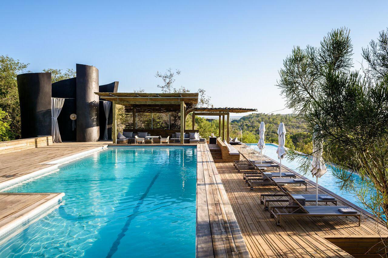 Luxury Travel Outdoors + Adventure Safaris Trip Ideas sky tree outdoor swimming pool leisure property estate Resort Pool vacation Villa real estate condominium backyard