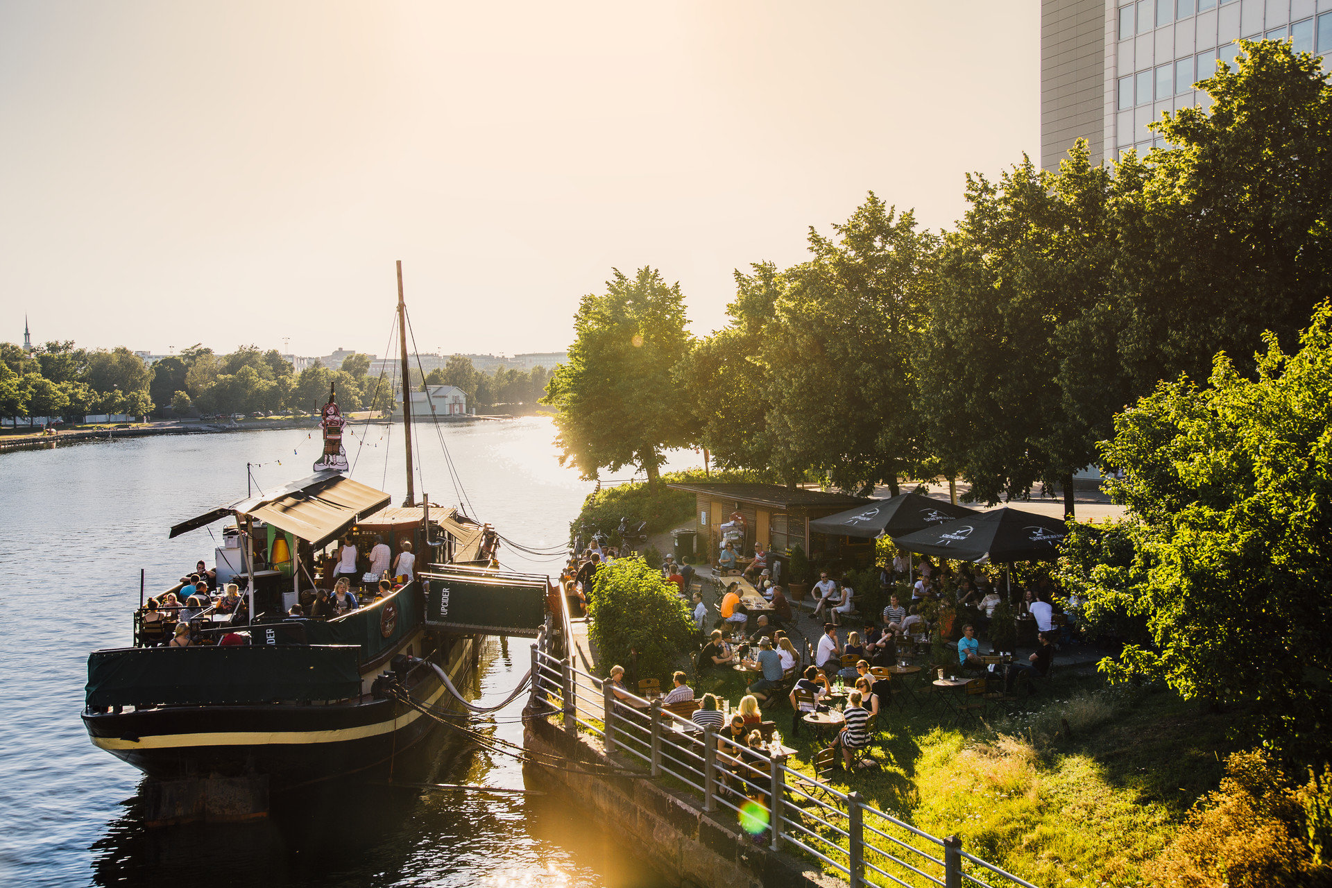 Boat Eat outdoor dining trees Trip Ideas Waterfront outdoor water tree sky reflection River body of water vehicle Canal waterway season morning evening flower autumn