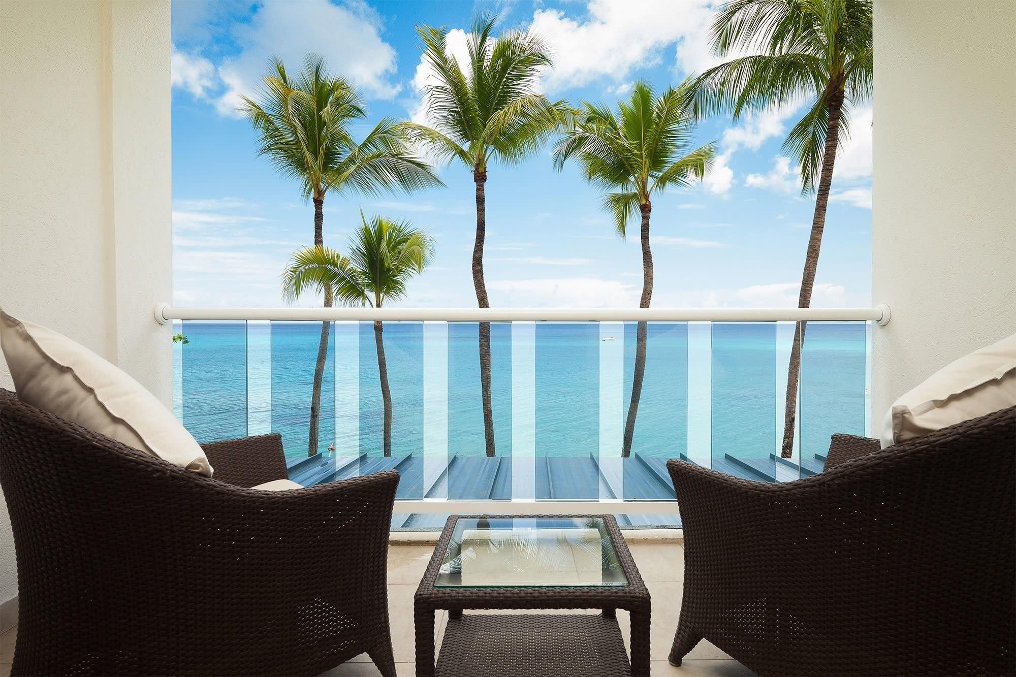 All-Inclusive Resorts Hotels water Resort property vacation palm tree swimming pool arecales real estate estate table condominium home caribbean hotel outdoor furniture Sea tropics Balcony Ocean leisure window apartment Villa penthouse apartment overlooking furniture