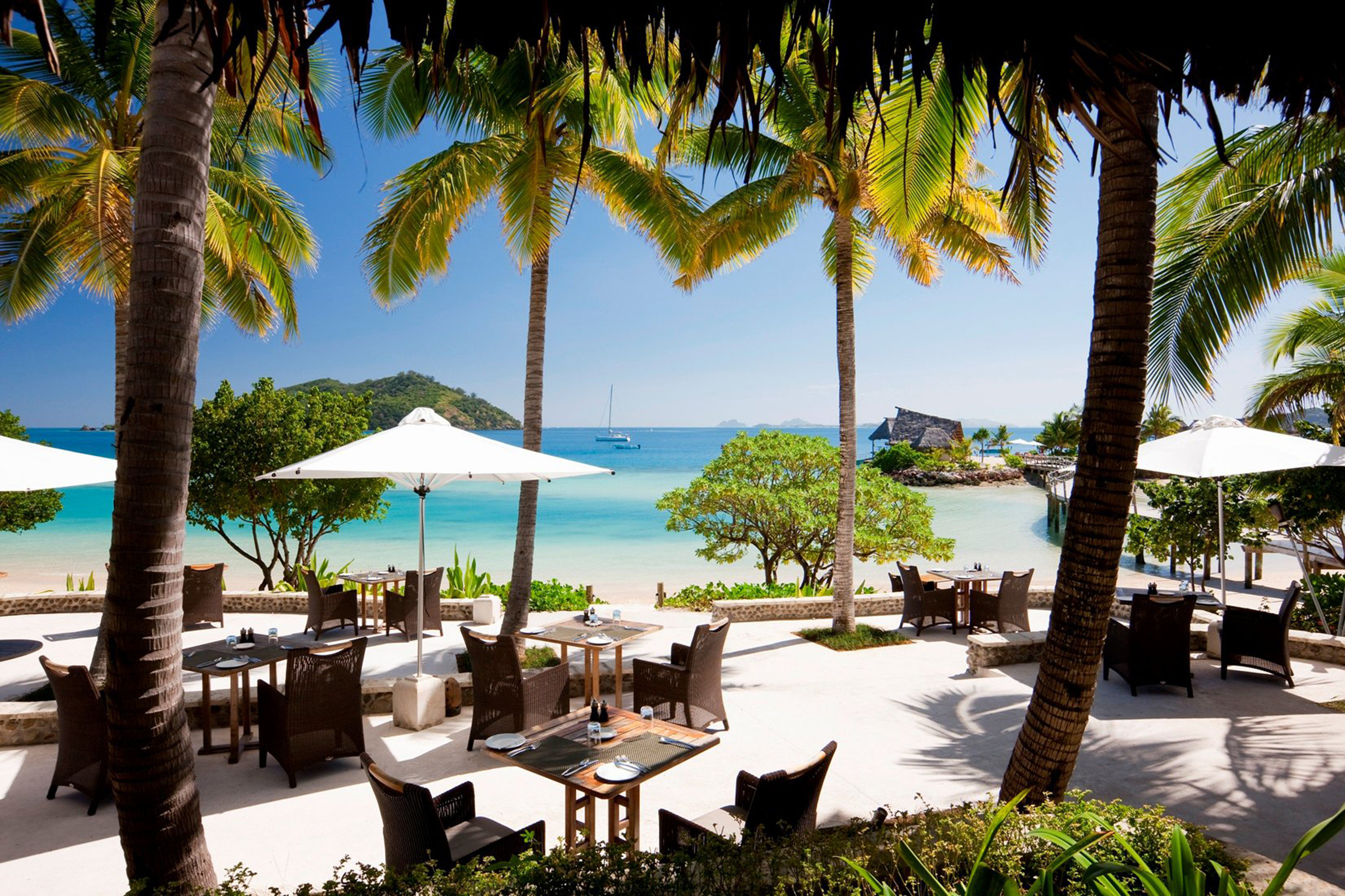 All-Inclusive Resorts Beach Boutique Hotels Dining Drink Eat Hotels Patio Romance Scenic views Terrace tree outdoor sky palm water leisure Resort plant vacation arecales caribbean estate tourism swimming pool palm family tropics Villa furniture lined shore shade several