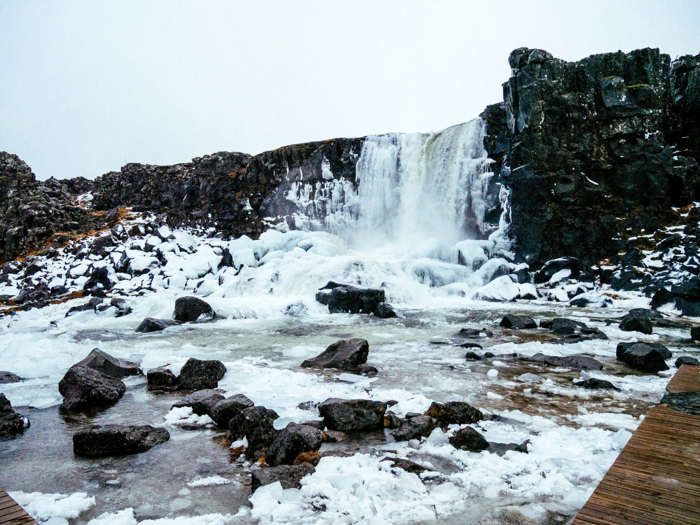 Iceland Offbeat Trip Ideas Nature outdoor Waterfall shore body of water water rock Coast Winter Sea weather Ocean wave snow wind wave season water feature River rapid landscape Beach stream material terrain
