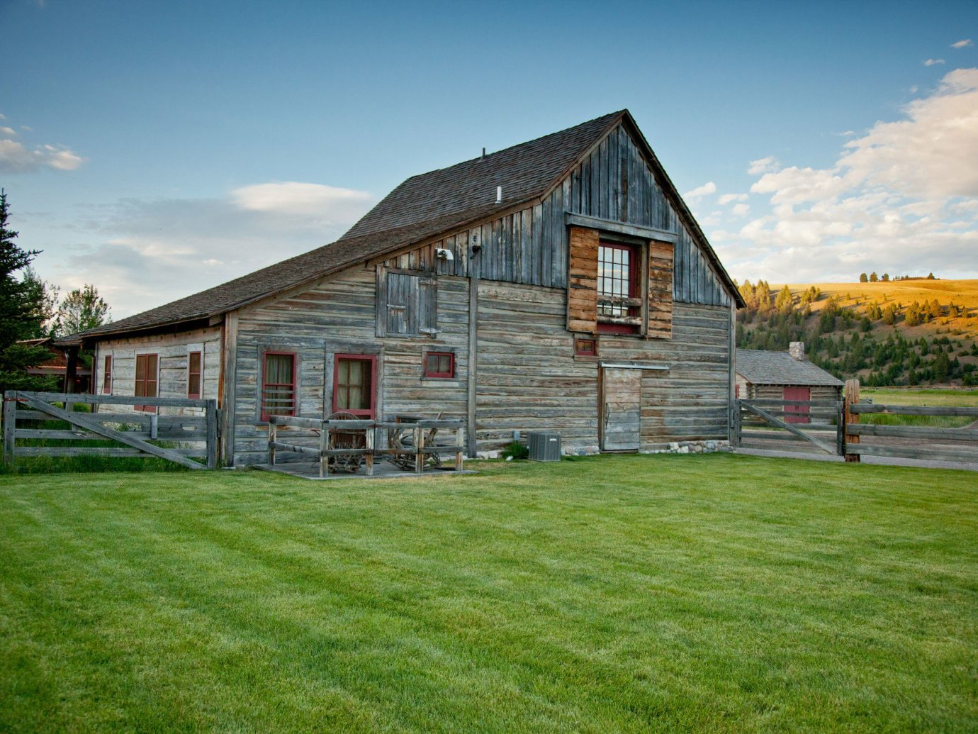 Cabin calm Exterior grass Greenery isolation log cabin Mountains Nature Outdoors remote Rustic serene trees Trip Ideas sky outdoor building house property home estate field residential area lawn barn real estate Farm farmhouse rural area cottage facade grassy siding backyard farm building lush