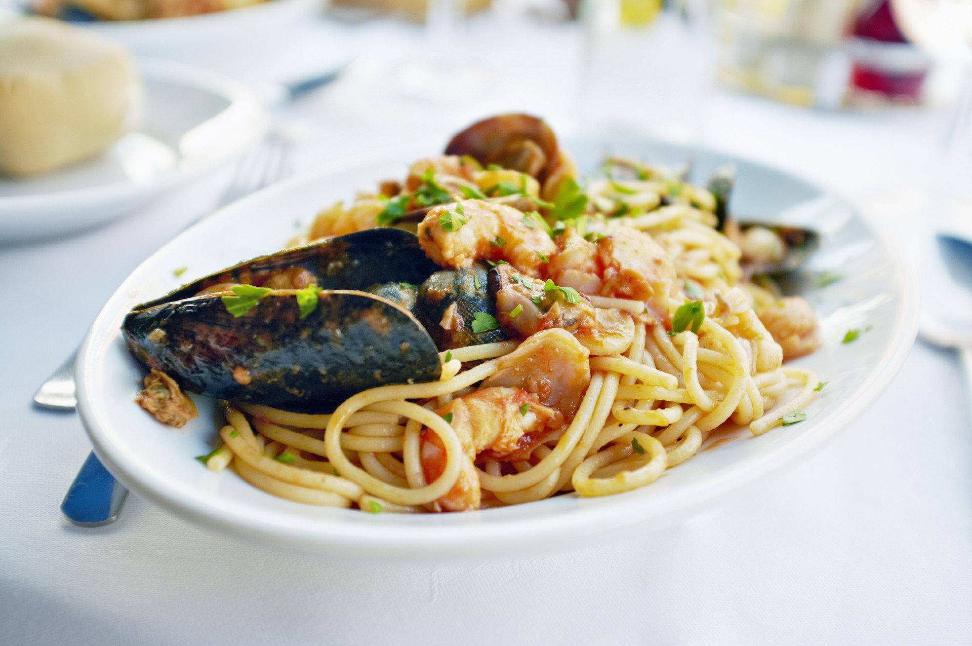 Budget Trip Ideas plate food dish spaghetti cuisine fish italian food produce thai food european food meal Seafood pasta vegetable pad thai linguine asian food chinese food