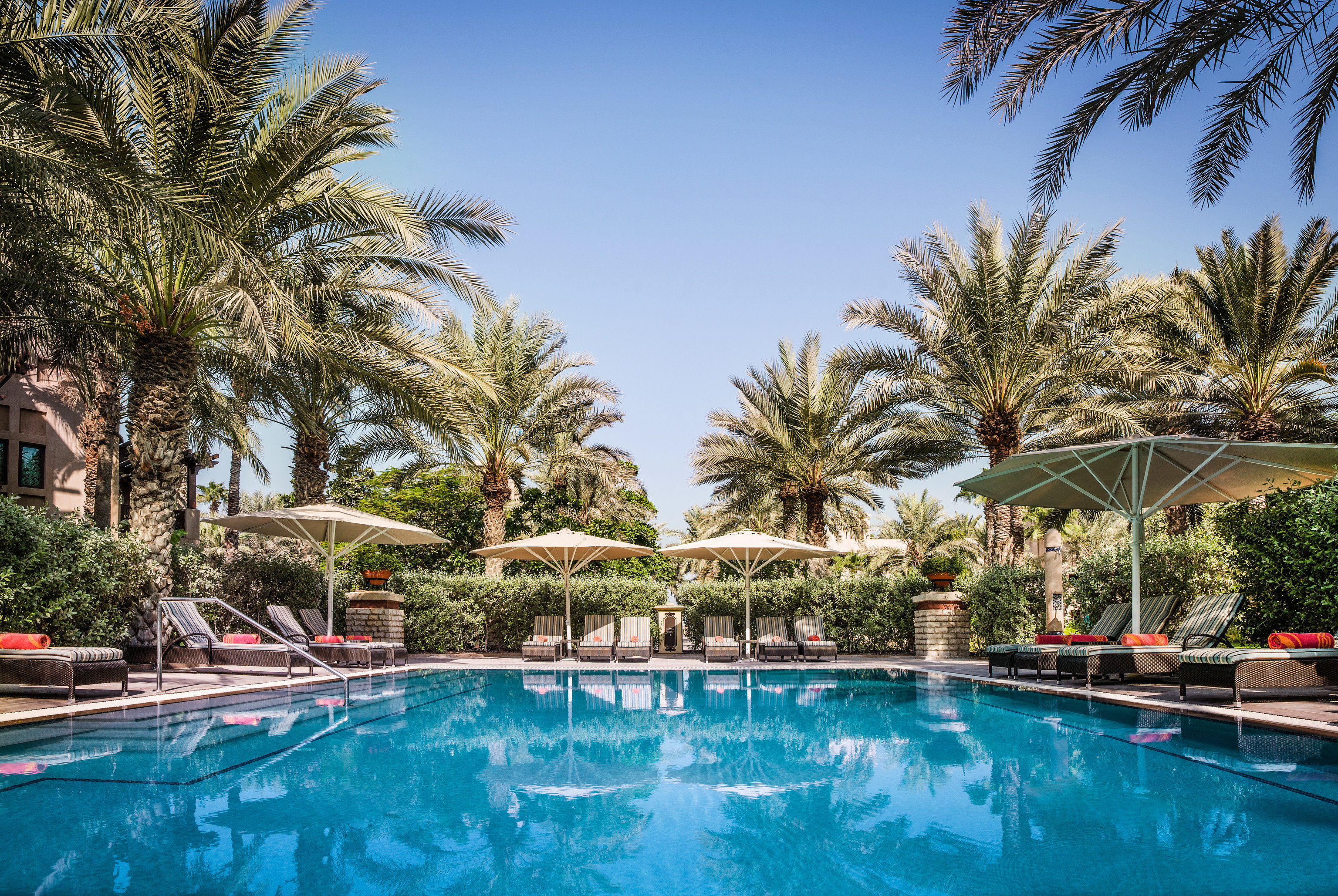 Dubai Hotels Luxury Travel Middle East Resort swimming pool property palm tree arecales tree water leisure real estate plant estate Villa sky vacation hotel resort town tropics hacienda tourism