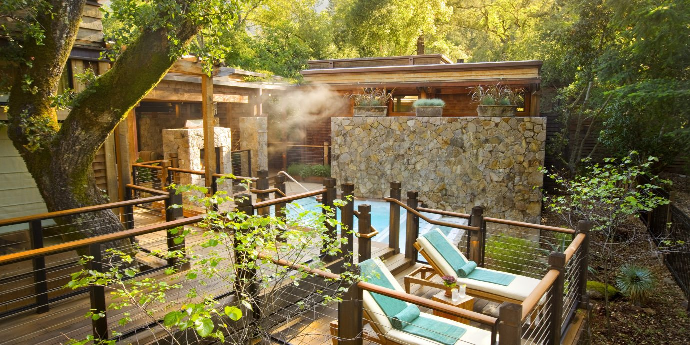 Eco Health + Wellness Hot tub Hotels Luxury Outdoors Ranch Romance Romantic Rustic Spa Retreats Trip Ideas Wellness tree outdoor property building house backyard yard cottage estate home Garden Resort real estate Villa outdoor structure Courtyard porch