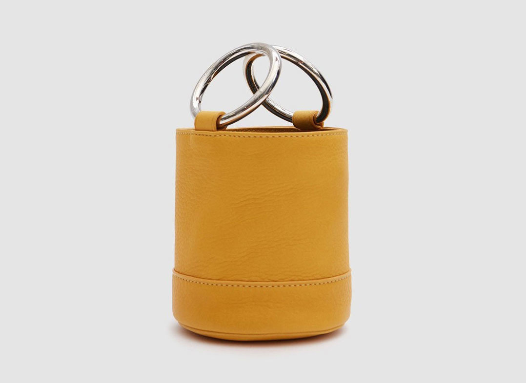 Travel Shop Travel Trends yellow fashion accessory product bag leather handbag product design brand coin purse accessory