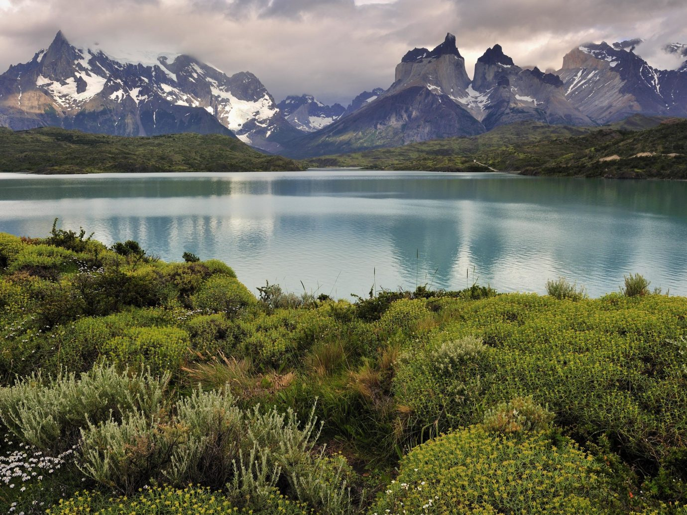 Jetsetter Guides Packing Tips Travel Tips Trip Ideas mountain grass outdoor sky highland Nature mountainous landforms water Lake wilderness River atmospheric phenomenon loch tarn reflection mountain range fell reservoir hill landscape fjord meadow plateau national park valley pond surrounded hillside lush