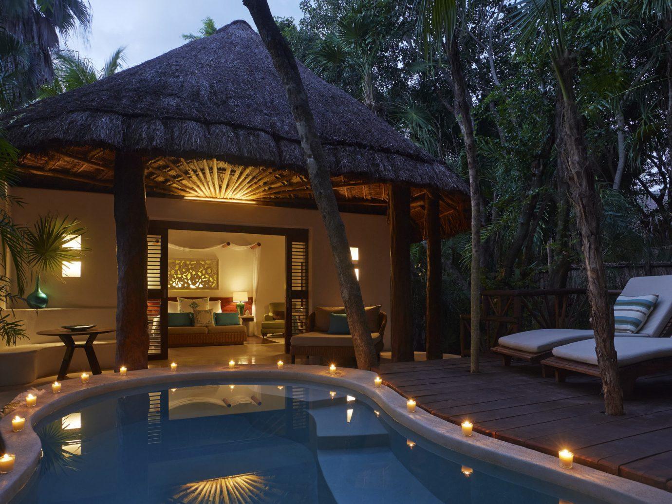 Beach Honeymoon Hotels Mexico Romance Tulum tree outdoor swimming pool estate Resort building house vacation home Villa mansion backyard restaurant