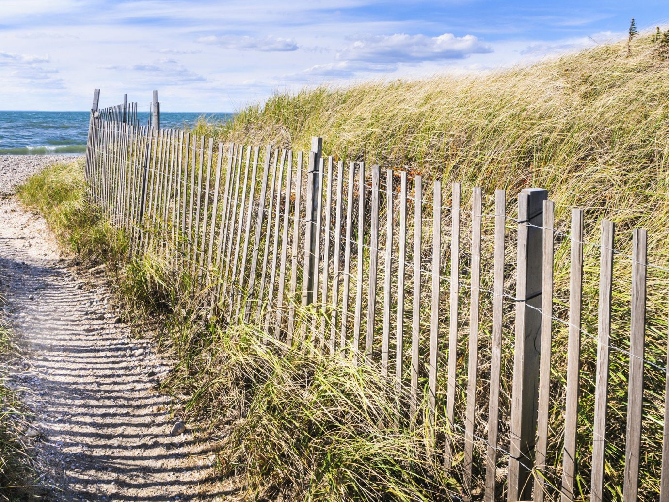 Beach East Coast USA Trip Ideas Fence sky outdoor grass habitat agriculture natural environment tree ecosystem walkway grass family field wetland outdoor structure Coast home fencing shrub marsh overlooking