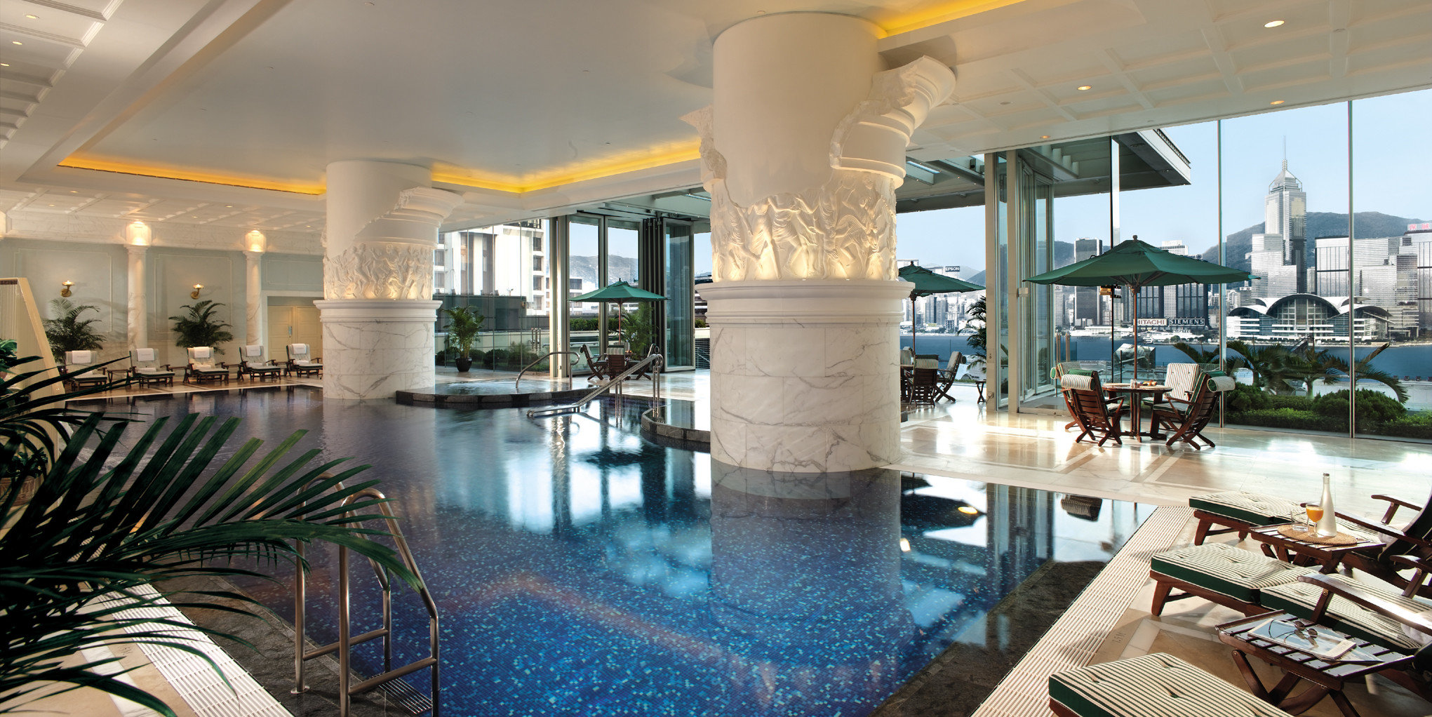 Hotels indoor floor leisure swimming pool chair property Resort ceiling estate room condominium vacation Lobby interior design restaurant real estate palace Dining mansion furniture Villa several