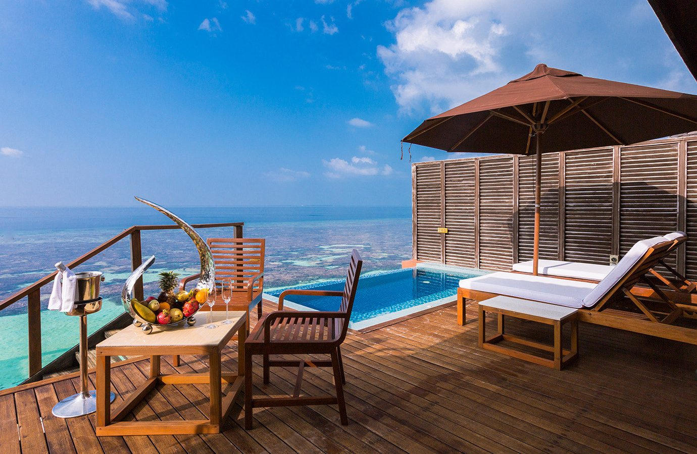 All-Inclusive Resorts Hotels sky floor Sea swimming pool Resort property chair vacation leisure real estate wooden sunlounger estate water Ocean outdoor furniture Villa resort town tourism tropics house hotel penthouse apartment outdoor structure caribbean condominium amenity Deck furniture several