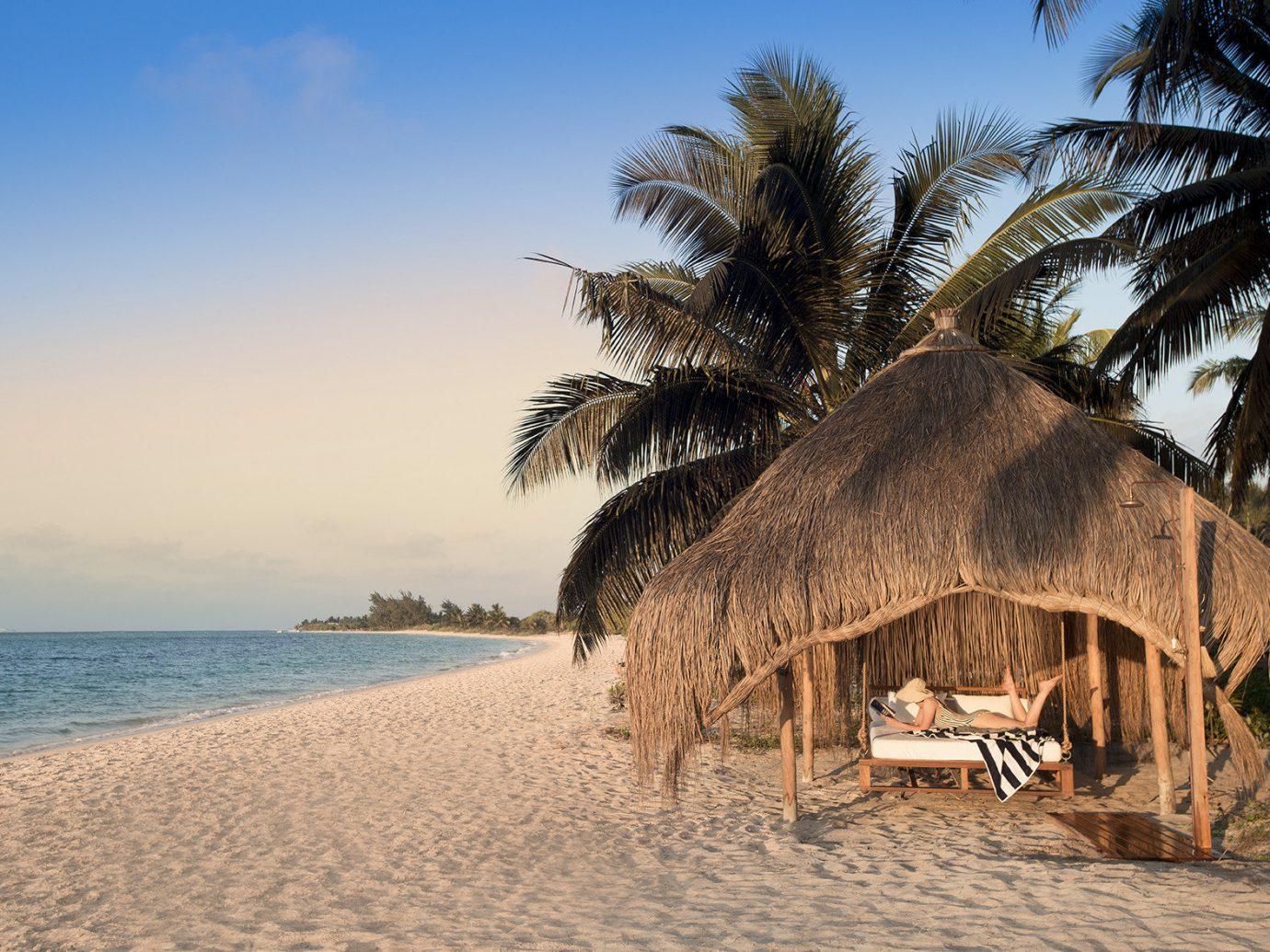 Trip Ideas outdoor tree sky water Beach palm vacation Sea Ocean arecales hut sand Resort Nature shore Coast tropics plant sandy
