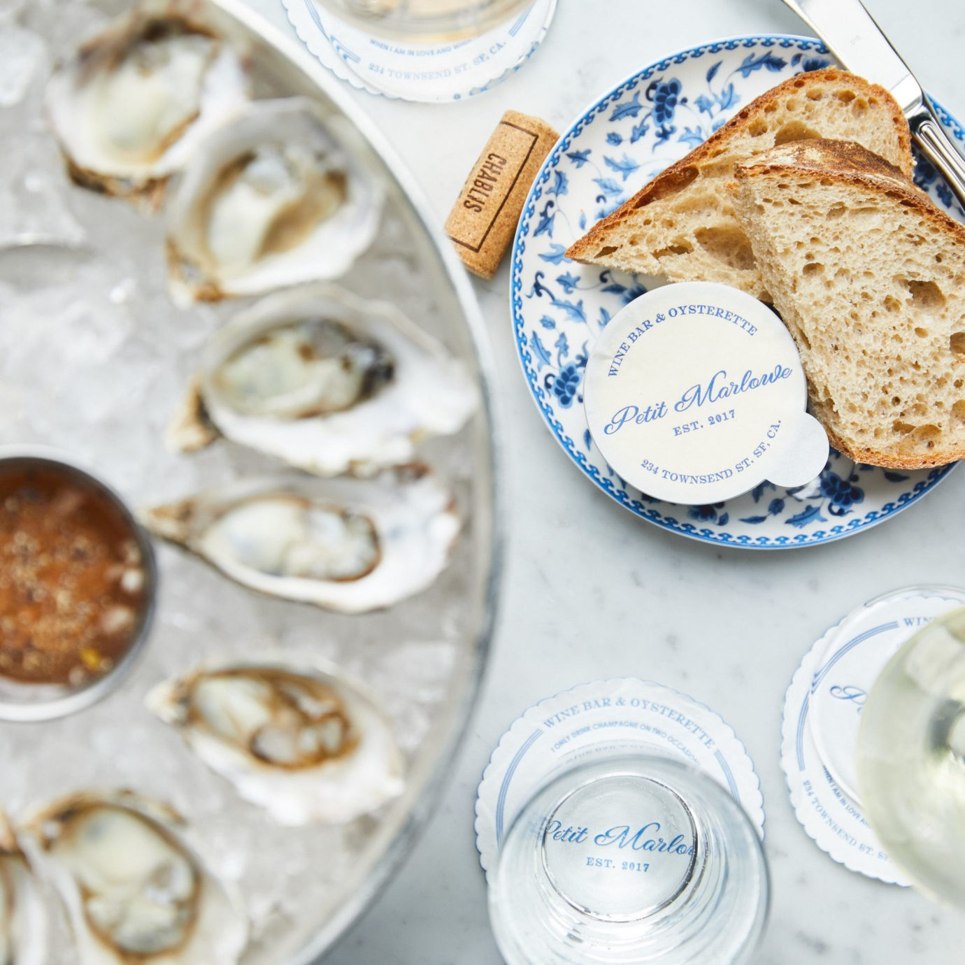 Food + Drink Travel Tips plate food dairy product dish breakfast oyster flavor recipe finger food several meal