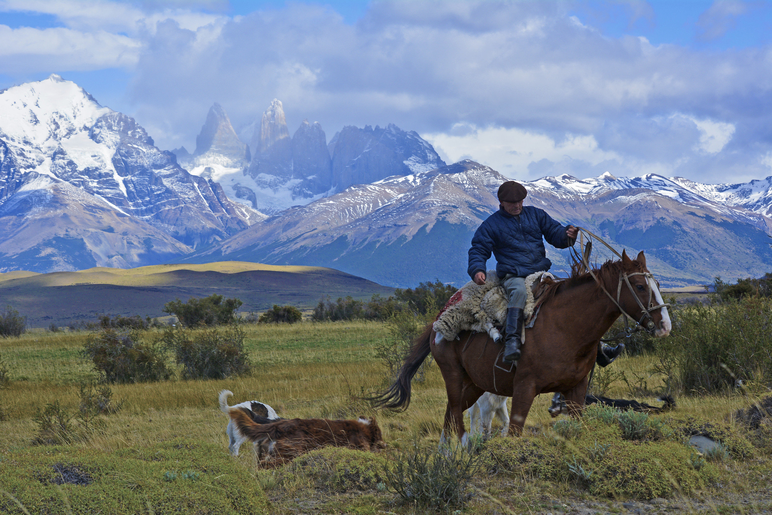 Jetsetter Guides Packing Tips Travel Tips Trip Ideas grass sky mountain outdoor mountainous landforms field wilderness landform mountain range pasture ecosystem grassland landscape meadow plateau alps mammal valley Adventure backpacking trail riding distance highland