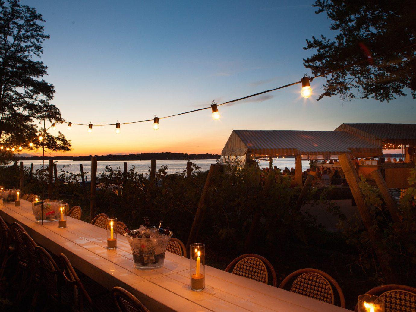 ambient lighting Beachfront dusk Ocean Romance Romantic string lights Sunset Trip Ideas Weekend Getaways tree outdoor sky night light evening lighting Resort day