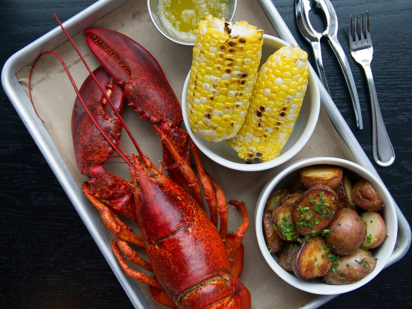 Secret Getaways Trip Ideas food table plate dish meal Seafood fish lobster animal source foods seafood boil produce invertebrate container decapoda cuisine crustacean