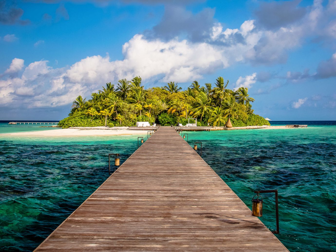 wooden bridge to an island at Coco Privé, Maldives