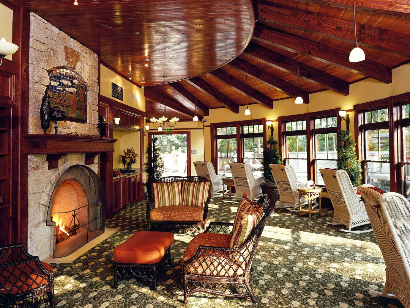 Classic Fireplace Hotels Lakes + Rivers Lounge Luxury Mountains New York Outdoor Activities Resort Romance Romantic Hotels indoor property room ceiling Living estate living room home furniture interior design log cabin cottage mansion Lobby area several