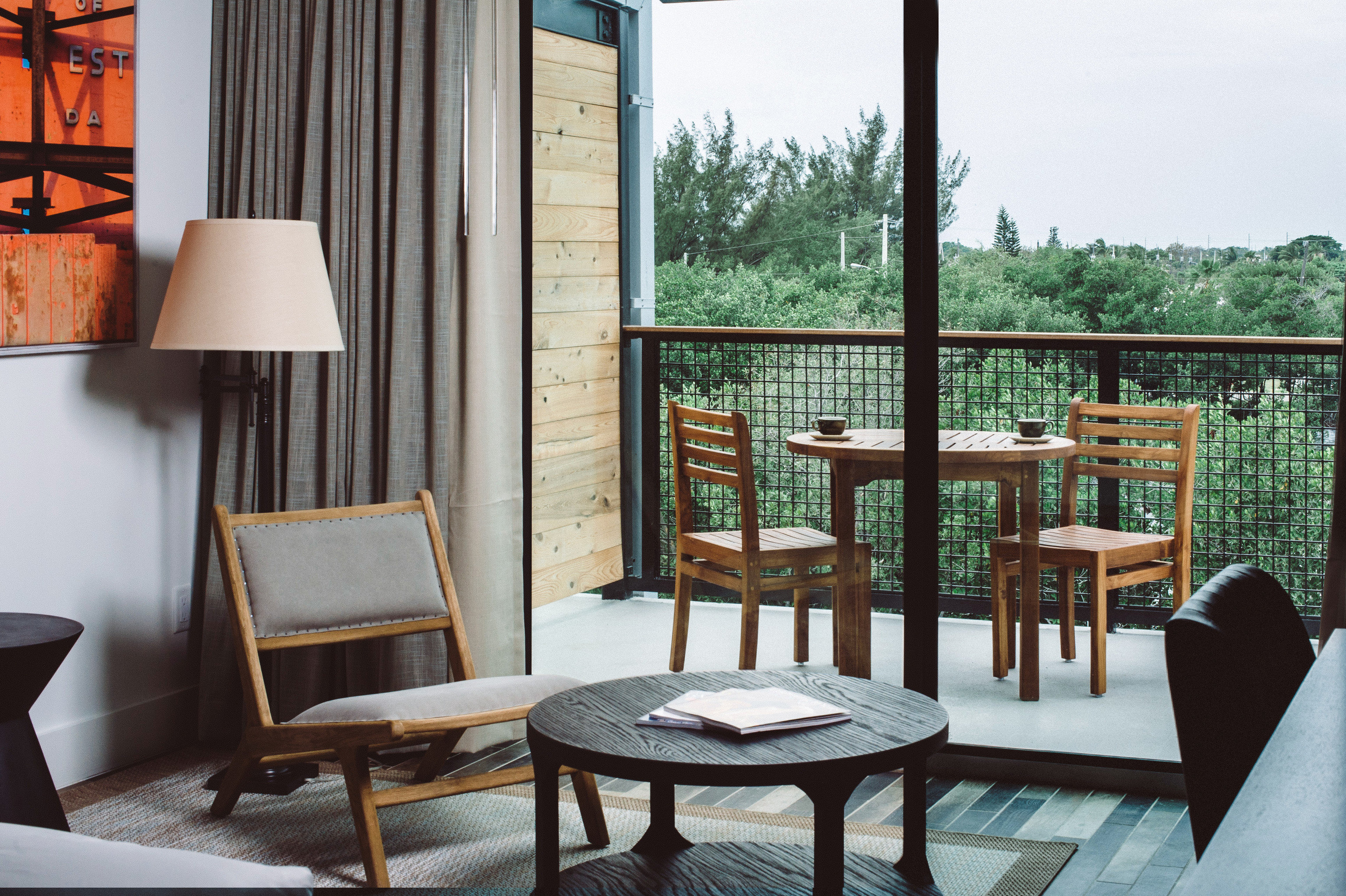 Hotels Romance floor table room chair indoor Living furniture interior design window real estate home living room outdoor structure house Balcony area arranged dining table
