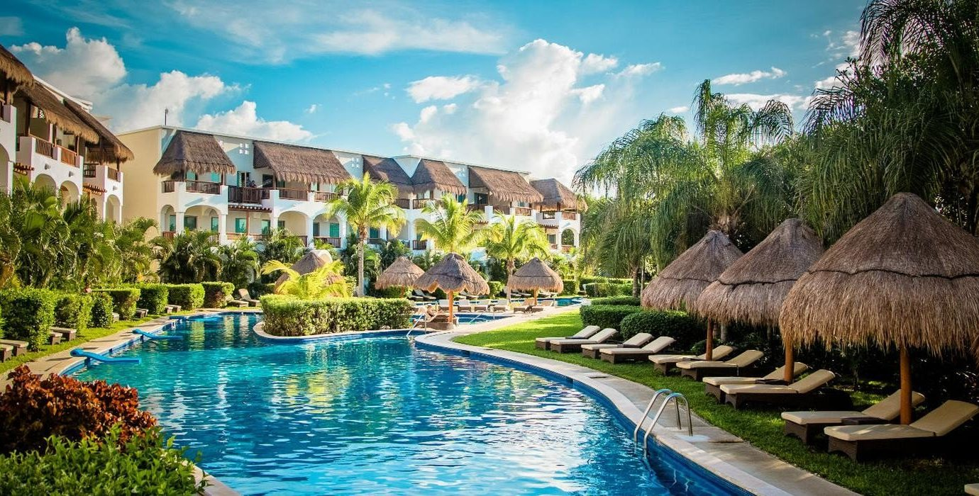 All-Inclusive Resorts Hotels outdoor water sky umbrella Resort leisure swimming pool house estate tourism tree resort town reflection real estate lawn hacienda hotel vacation recreation Pool watercourse computer wallpaper lined surrounded several day