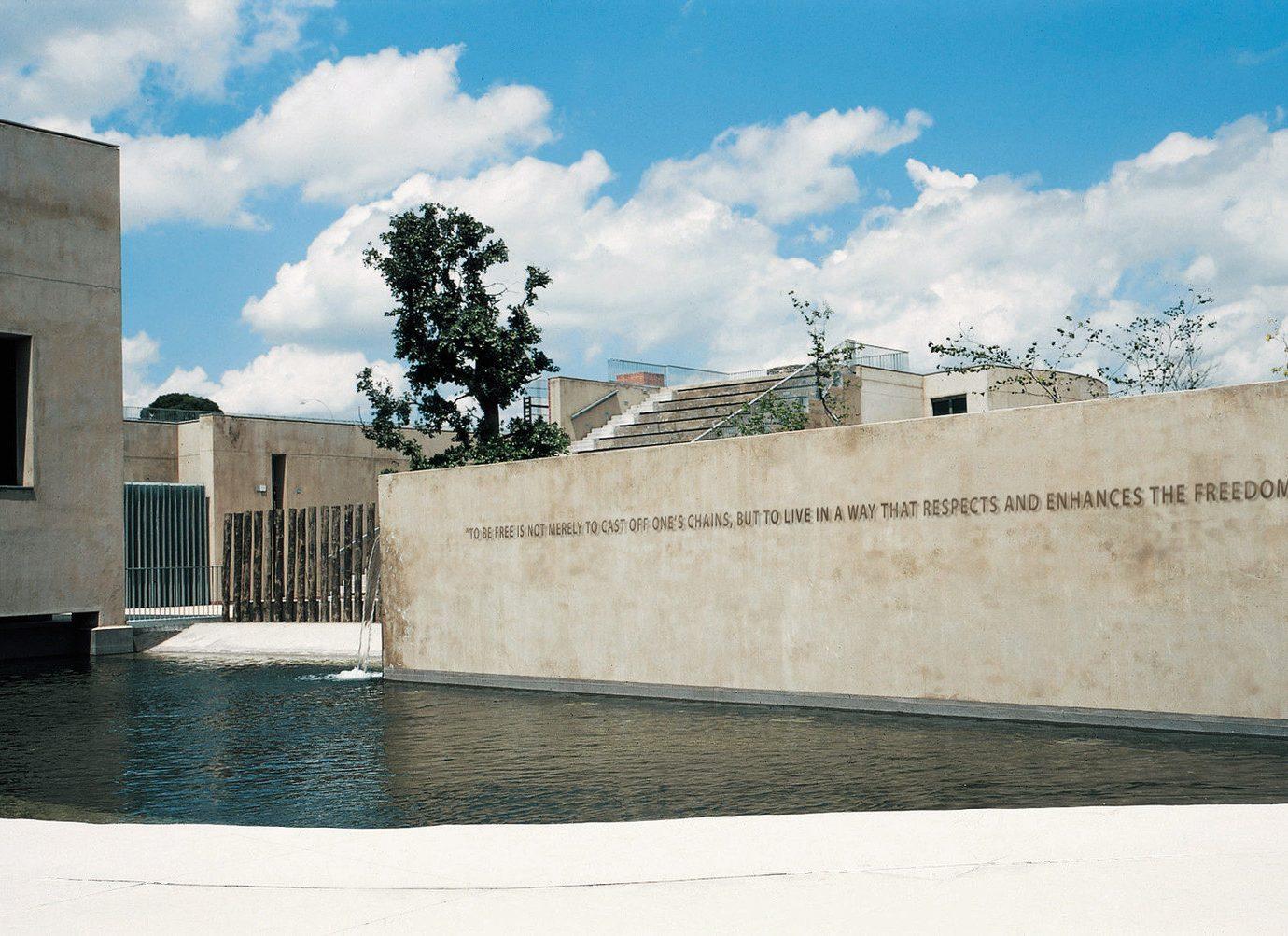 Trip Ideas building outdoor blue Architecture wall facade estate home concrete cement