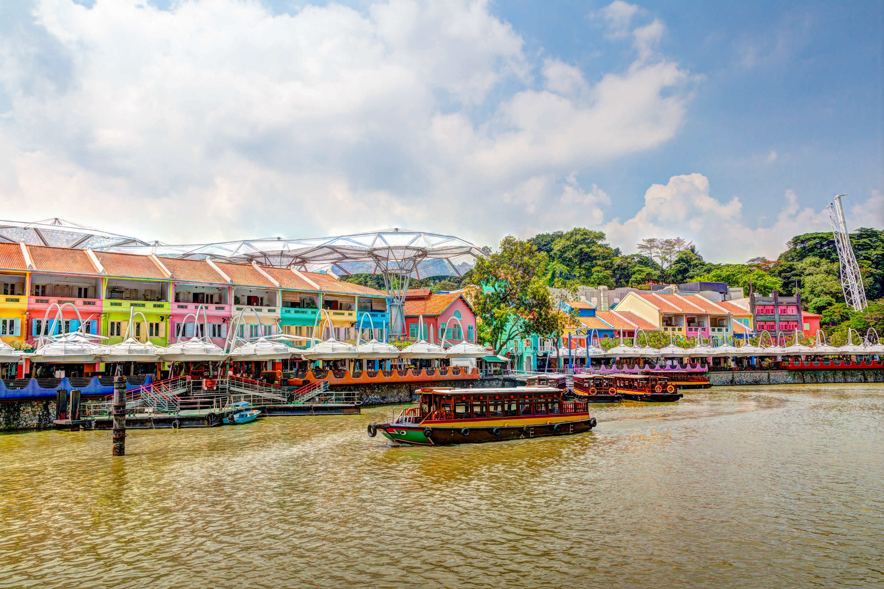 Offbeat Singapore Trip Ideas waterway water transportation sky water leisure Boat reflection tourist attraction tree River tourism City plant Resort recreation Canal landscape Lake boating