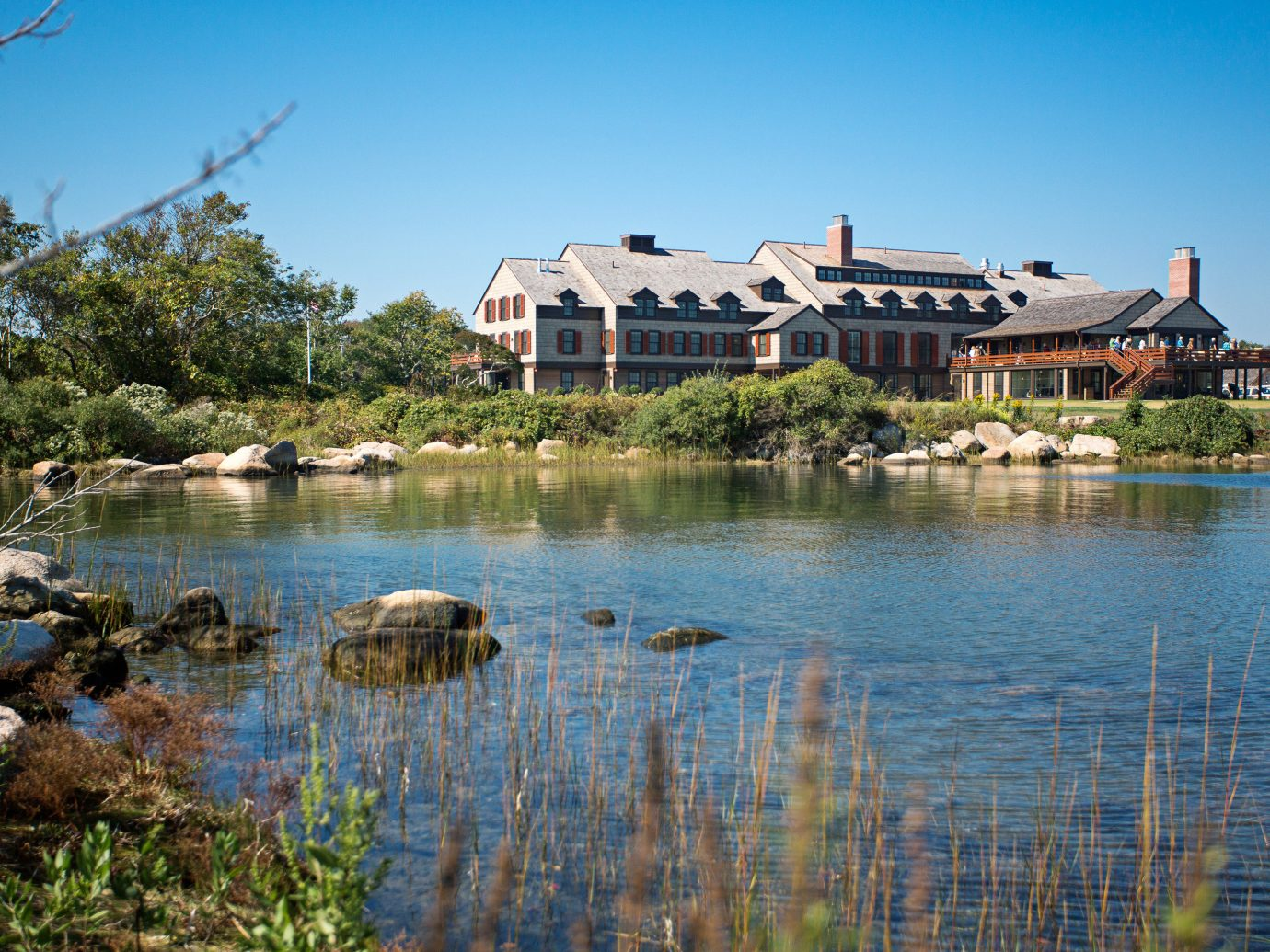 Classic Exterior Grounds Inn Nature Outdoors water outdoor sky reflection body of water Lake River house pond estate reservoir Sea shore surrounded