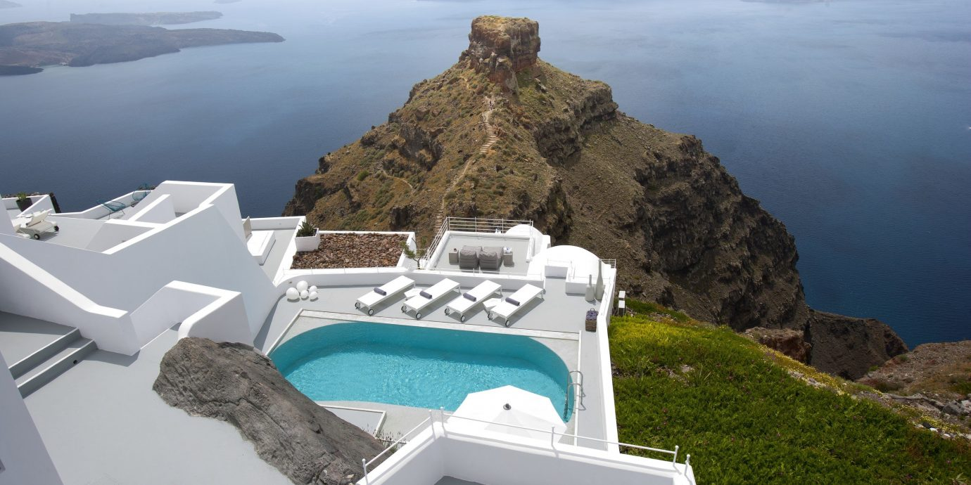 Greece Hotels Luxury Travel Santorini outdoor grass Nature mountain promontory Sea white sky tourism