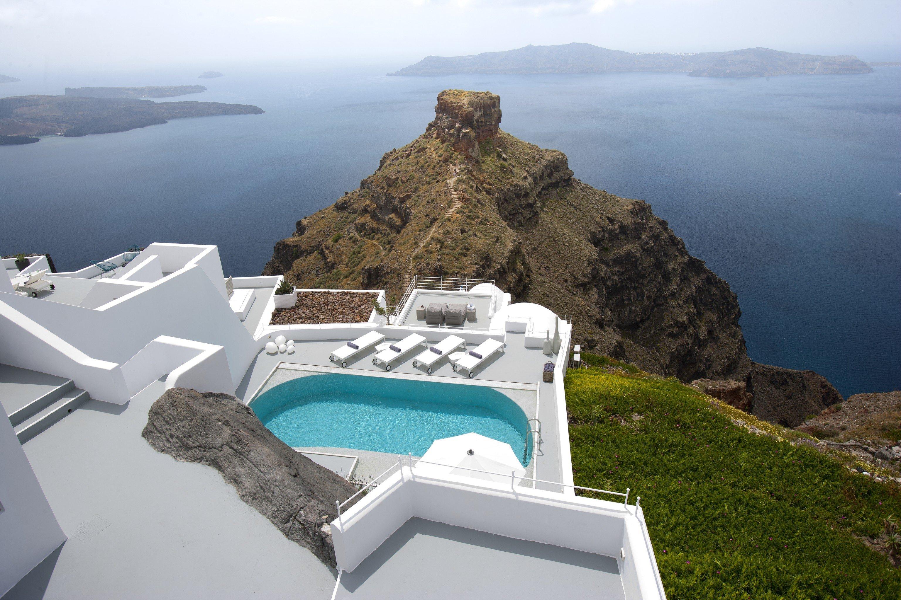 Greece Hotels Luxury Travel Santorini outdoor grass Nature mountain promontory Sea white sky tourism