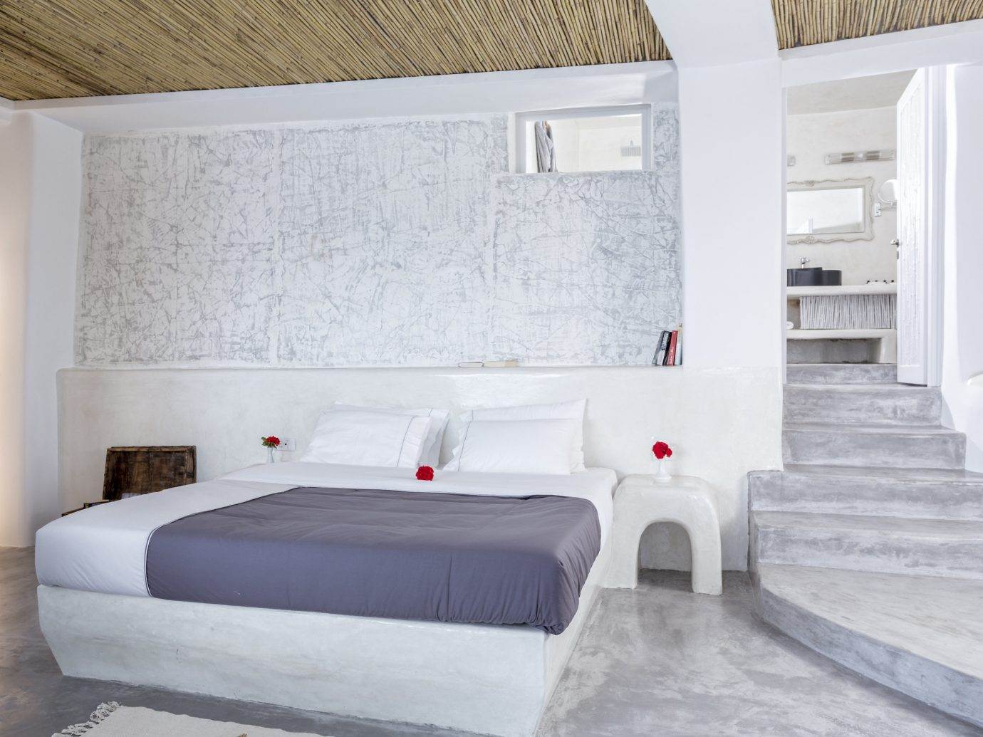 Greece Hotels Santorini indoor wall floor bed property room bed frame Architecture interior design Suite white ceiling Bedroom home furniture real estate hotel mattress interior designer house flooring estate daylighting boutique hotel loft