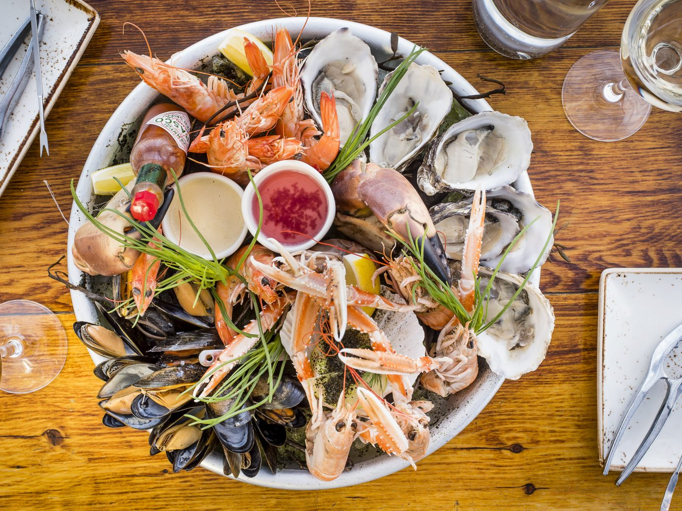 Trip Ideas table plate food dish meal cuisine fish Seafood produce mussel dinner variety