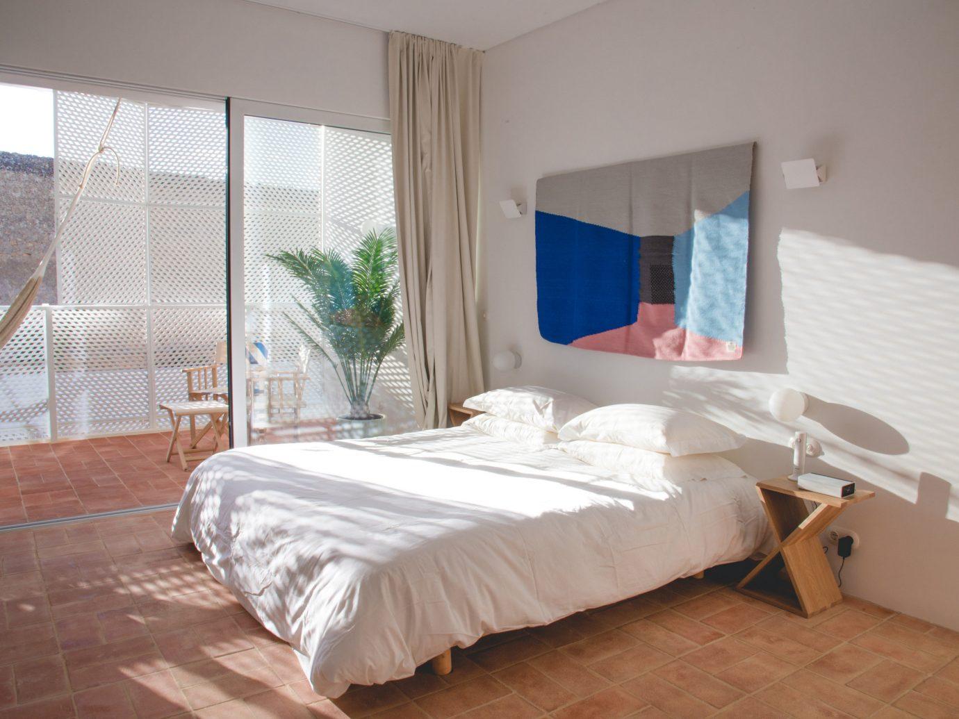 Hotels indoor bed window floor wall Bedroom room property cottage interior design Suite furniture real estate apartment hotel Villa bed frame