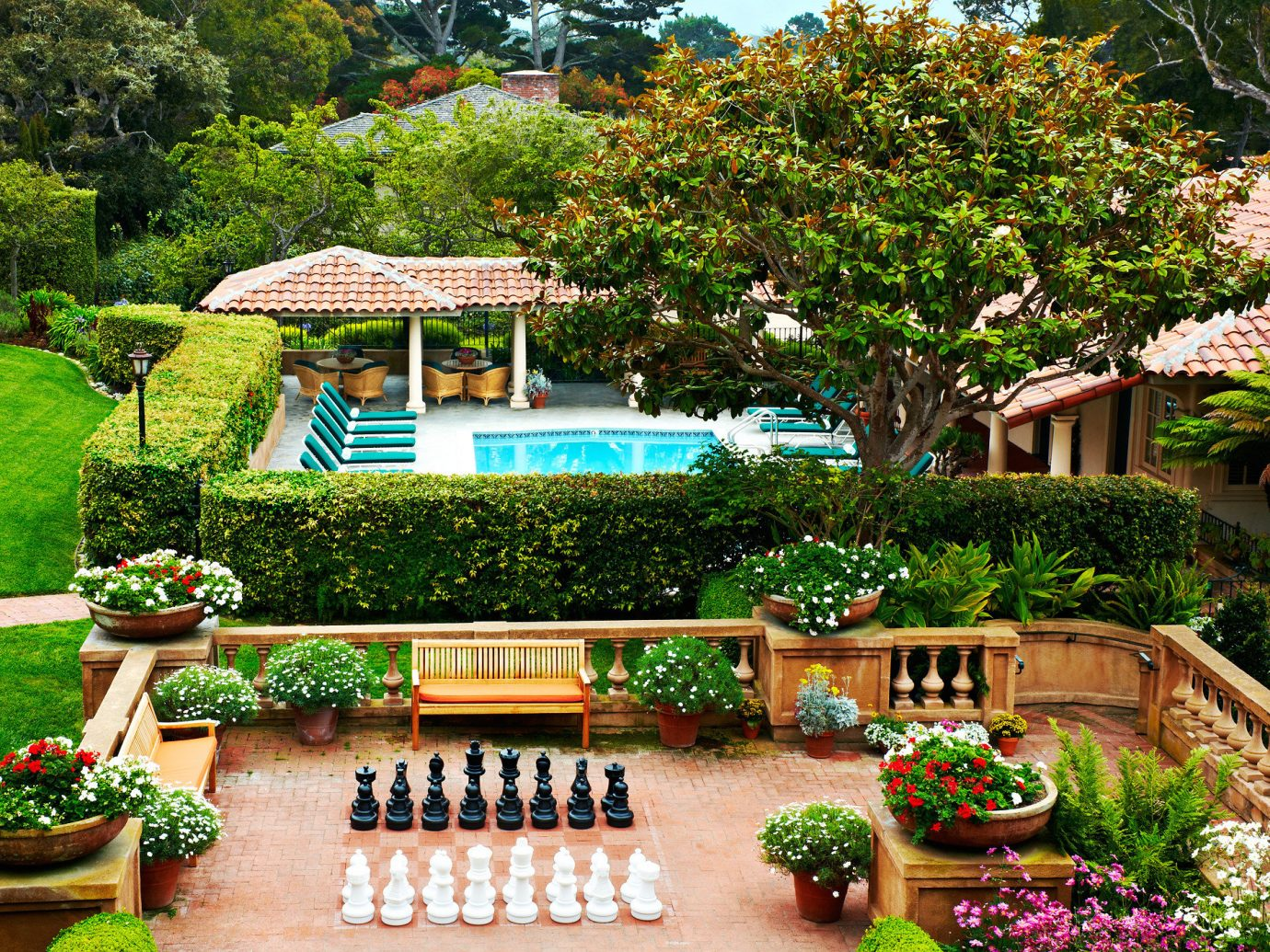 Food + Drink Garden Grounds Play Pool Resort tree outdoor flower plant botany backyard estate yard Courtyard botanical garden home park landscape architect outdoor structure lawn landscaping bushes decorated colorful