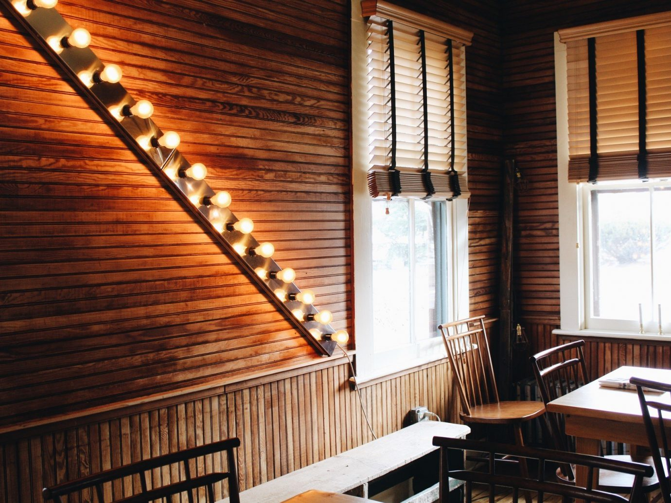 table wooden chair indoor window property room wood hardwood interior design window covering ceiling cottage Dining furniture