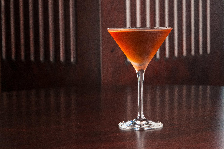 Food + Drink table sitting indoor Drink alcoholic beverage cocktail distilled beverage glass martini cosmopolitan liqueur