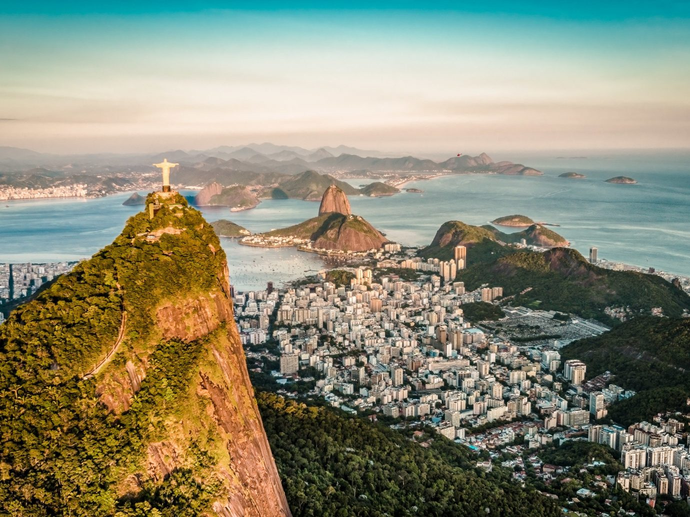 Beaches Brazil Travel Tips Trip Ideas sky water outdoor Sea rock landmark Nature City horizon Coast photography promontory rocky tourism morning Ocean mountain tree cloud terrain tourist attraction aerial photography hill cape cityscape travel skyline evening landscape panorama overlooking