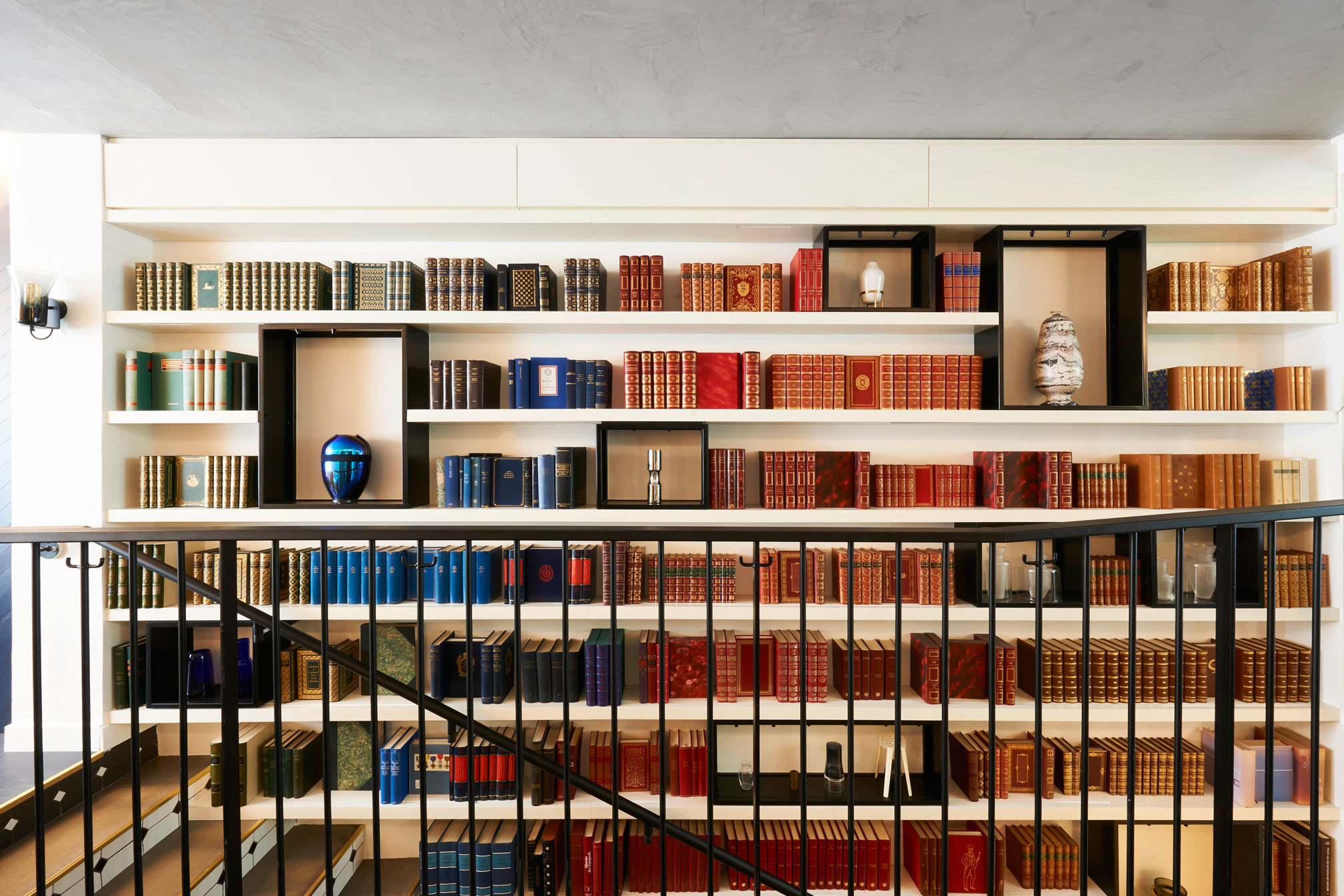 Hotels indoor library shelf ceiling public library building shelving furniture bookcase interior design bookshelf