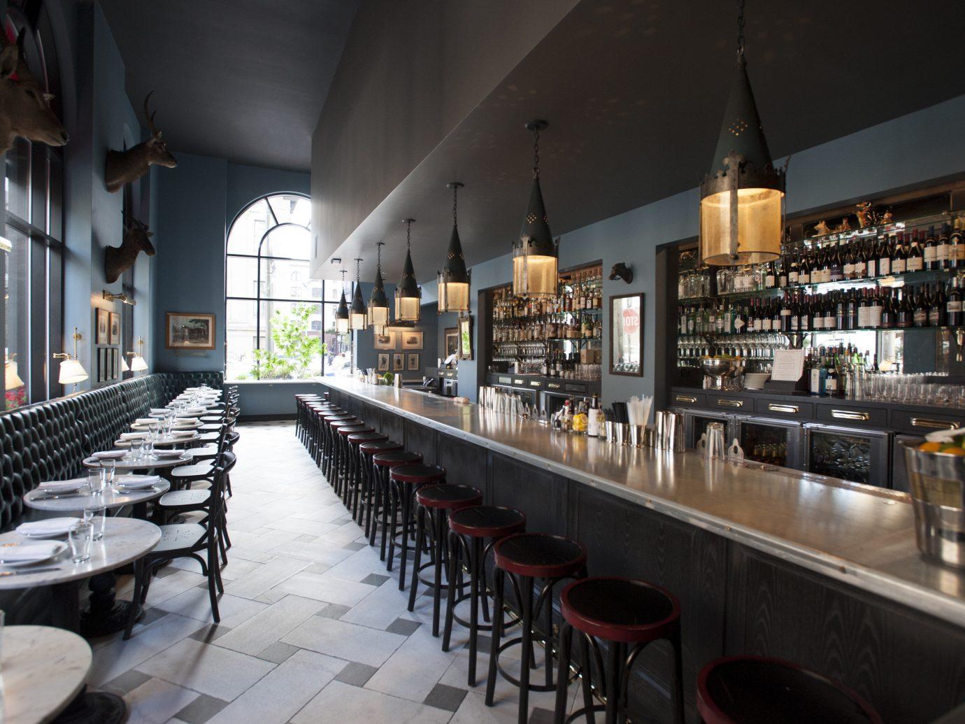Food + Drink indoor wine restaurant Bar long counter meal interior design café row lined line several dining room
