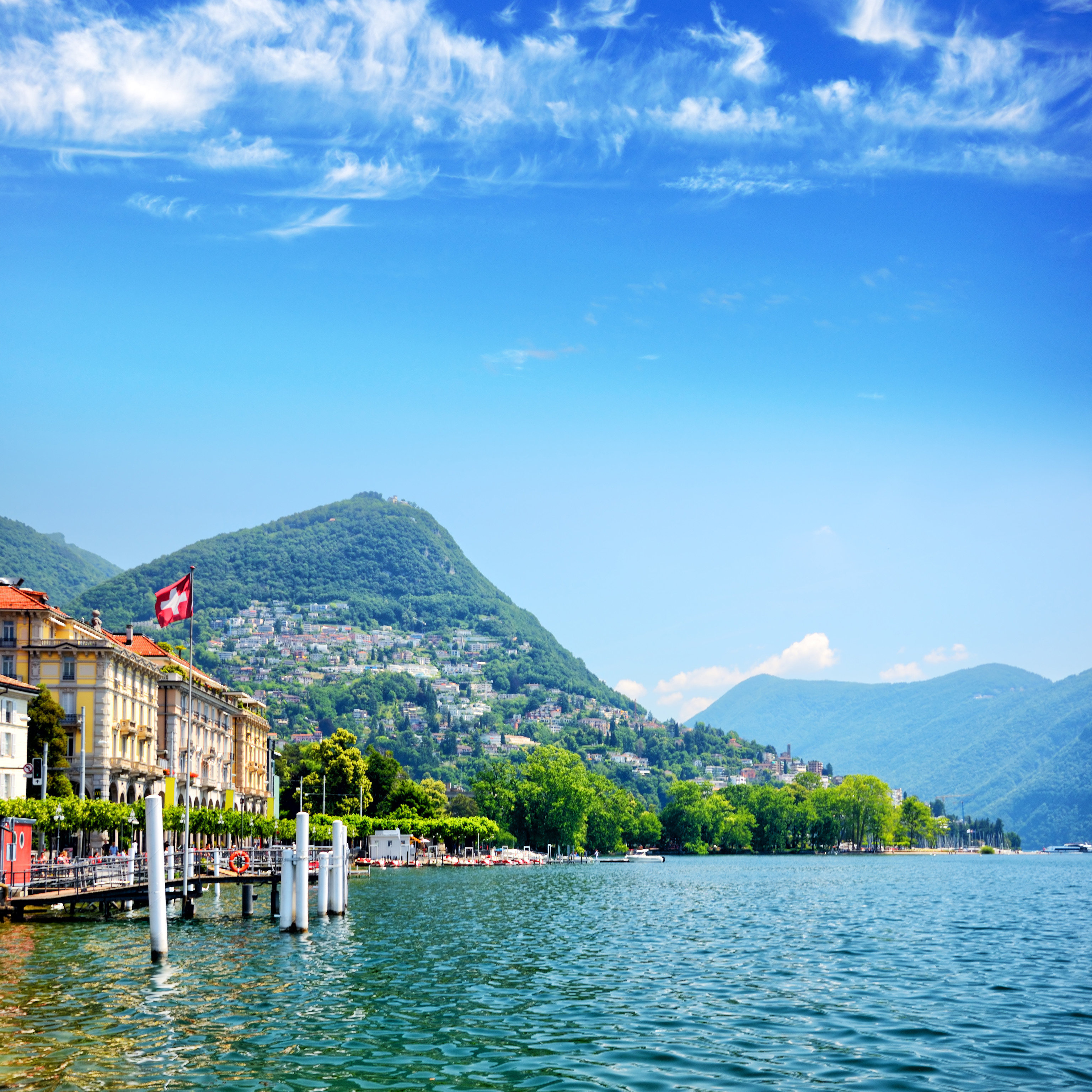 Secret Getaways Trip Ideas water outdoor mountain sky Boat mountainous landforms landform geographical feature body of water Lake mountain range Nature fjord Sea vacation loch reflection landscape bay docked vehicle alps reservoir glacial landform surrounded day